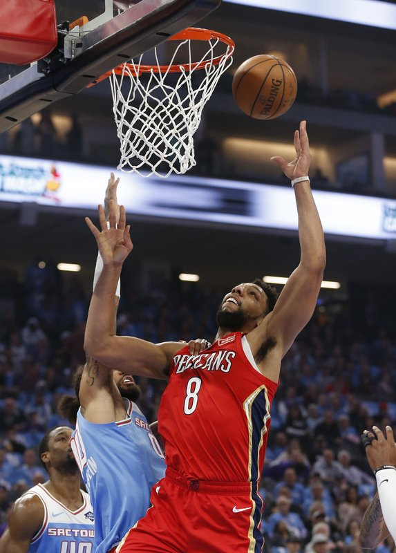 New Orleans Pelicans center Jahlil Okafor, right, goes up for the rebound against Sacramento Kings center Willie Cauley-Stein during the first half of an NBA basketball game, Sunday, April 7, 2019, in Sacramento, Calif. (AP Photo/Rich Pedroncelli)