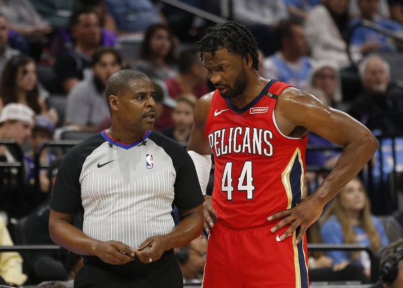 New Orleans Pelicans forward Solomon Hill, right, talks with referee Leroy Richardson during a break in the action in the first half of the team's NBA basketball game against the Sacramento Kings, Sunday, April 7, 2019, in Sacramento, Calif. (AP Photo/Rich Pedroncelli)