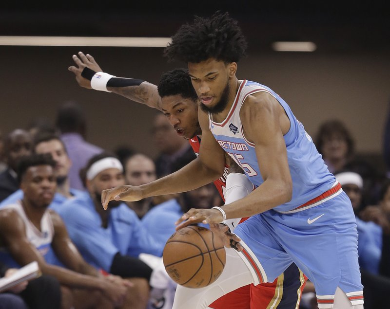 New Orleans Pelicans guard Elfrid Payton, left, reaches for the ball next to Sacramento Kings forward Marvin Bagley IIIl, right, during the first half of an NBA basketball game Sunday, April 7, 2019, in Sacramento, Calif. (AP Photo/Rich Pedroncelli)