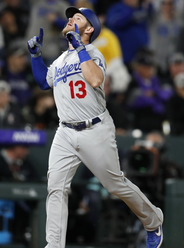Los Angeles Dodgers' Max Muncy gestures after hitting a two-run home run off Colorado Rockies relief pitcher Carlos Estevez during the sixth inning of a baseball game Sunday, April 7, 2019, in Denver. (AP Photo/David Zalubowski)