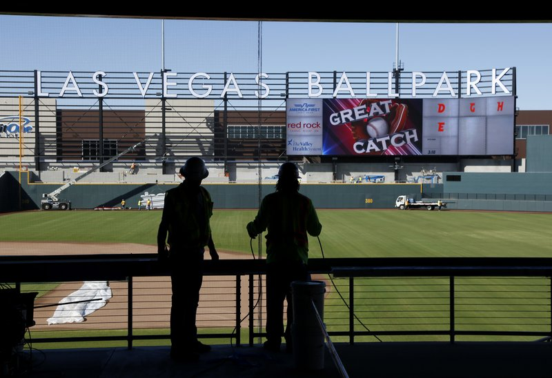 In this, March 28, 2019, photo, workers continue construction on a new baseball park in Las Vegas. The park will be the home of the minor league Las Vegas Aviators. (AP Photo/John Locher)