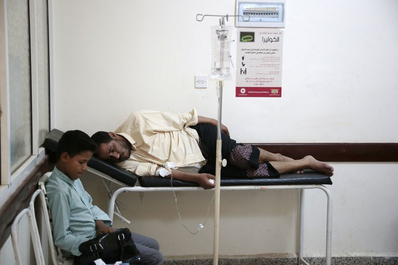 FILE - In this July 1, 2017 file photo, a man is treated for suspected cholera infection at a hospital in Sanaa, Yemen. (AP Photo/Hani Mohammed, File)