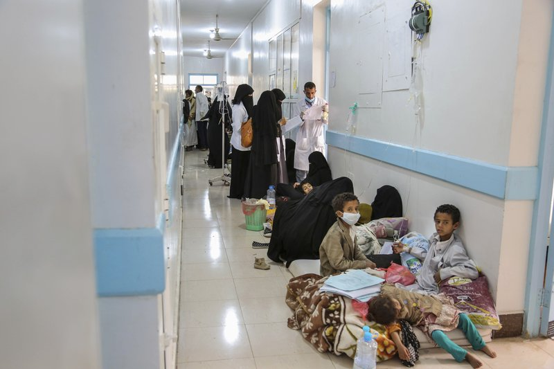In this May 12, 2017 photo released by UNICEF, patients suffering from severe diarrhea and suspected of cholera, wait to receive treatment, at a hospital in Sanaa, Yemen. (UNICEF via AP)