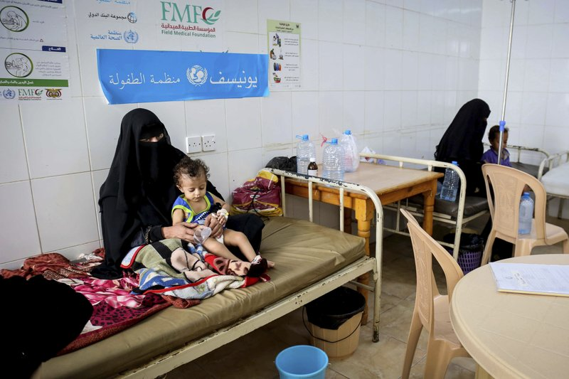 In this Sept. 16, 2017 photo released by UNICEF, children receive treatment for cholera at a hospital in Saada, Yemen. (UNICEF via AP)