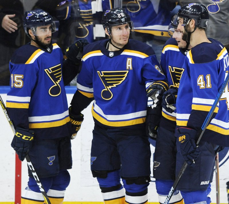 St. Louis Blues' Alexander Steen (20) is congratulated by Robby Fabbri (15) and Robert Bortuzzo (41) after his goal against the Philadelphia Flyers during the third period of an NHL hockey game Thursday, April 4, 2019, in St. (AP Photo/Bill Boyce)