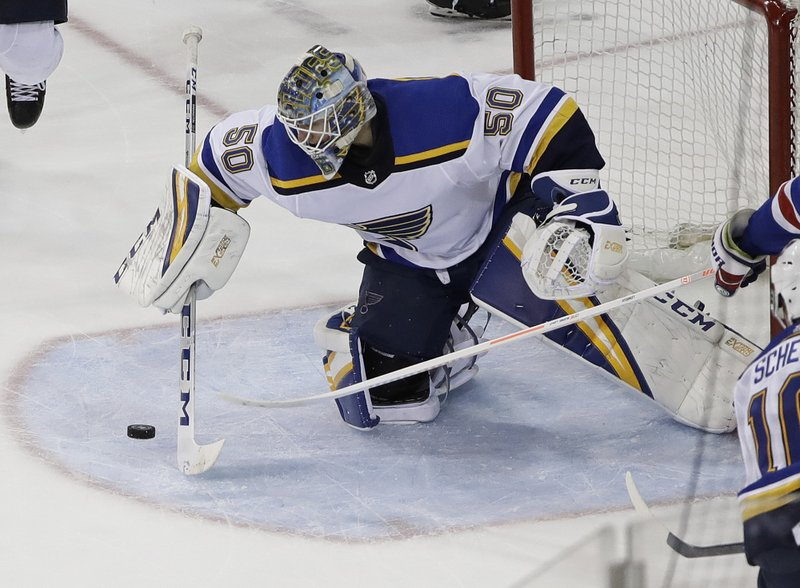St. Louis Blues' Jordan Binnington stops a shot on the goal by the New York Rangers during the third period of an NHL hockey game Friday, March 29, 2019, in New York. (AP Photo/Frank Franklin II)