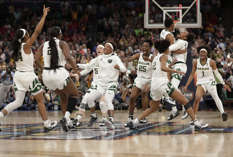 The Baylor team celebrates after defeating Notre Dame 82-81 during the Final Four championship game of the NCAA women's college basketball tournament Sunday, April 7, 2019, in Tampa, Fla. (AP Photo/John Raoux)