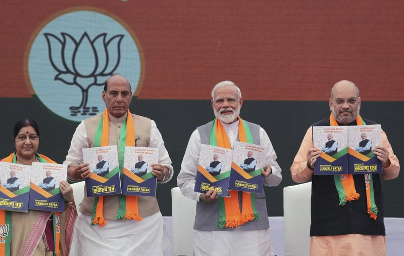 From Left, Indian Foreign Minister Suushma Swaraj, Home Minister Rajnath Singh, Indian Prime Minister Narendra Modi, Bharatiya Janata Party (BJP) president Amit Shah release BJP's manifesto for the upcoming general elections in New Delhi, India, Monday, April 8, 2019. (AP Photo/Manish Swarup)