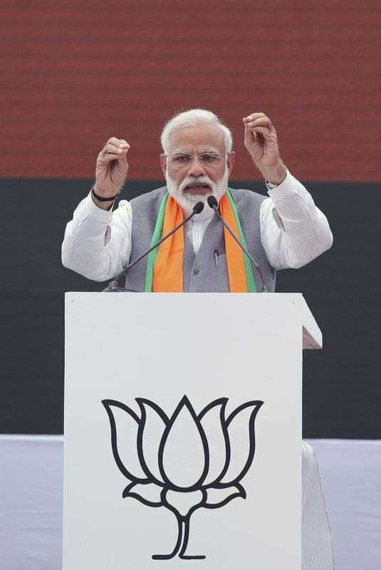 Indian Prime Minister Narendra Modi, left, speaks during the release BJP's manifesto for the upcoming general elections in New Delhi, India, Monday, April 8, 2019. (AP Photo/Manish Swarup)