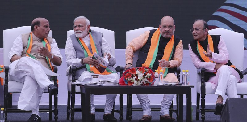 Indian Foreign Minister Suushma Swaraj, Indian Home Minister Rajnath Singh, left, talks with Indian Prime Minister Narendra Modi, as Bharatiya Janata Party (BJP) president Amit Shah, second right listens to Finance Minister Arun Jaitley rduring a function to elease BJP's manifesto for the upcoming general elections in New Delhi, India, Monday, April 8, 2019. (AP Photo/Manish Swarup)