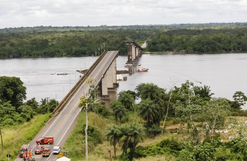 In this April 6, 2019 handout photo released by Para Government, a ferry boat collided with a bridge pillar causing part of the bridge to collapse in the Moju river, state of Para, Brazil. (Fernando Araujo/Para Government via AP)
