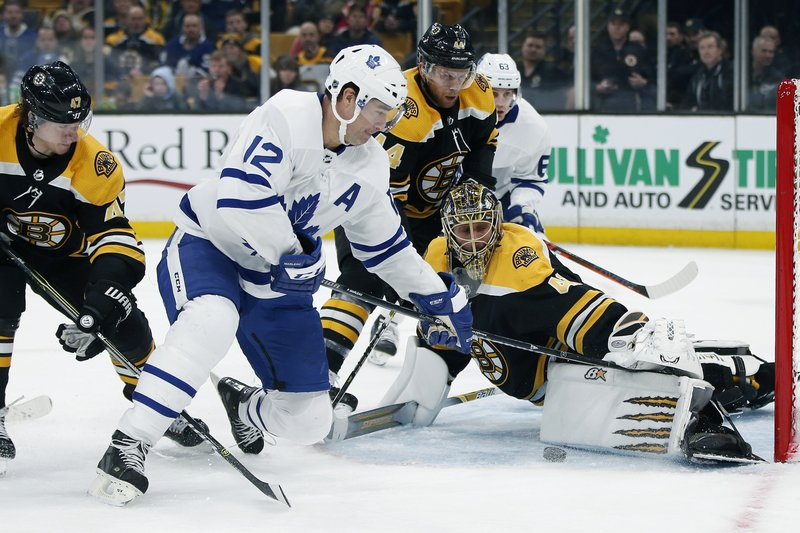 FILE - In this Dec. 8, 2018, file photo, Boston Bruins' Jaroslav Halak (41) blocks a shot by Toronto Maple Leafs' Patrick Marleau (12) during the third period of an NHL hockey game, in Boston. (AP Photo/Michael Dwyer, File)