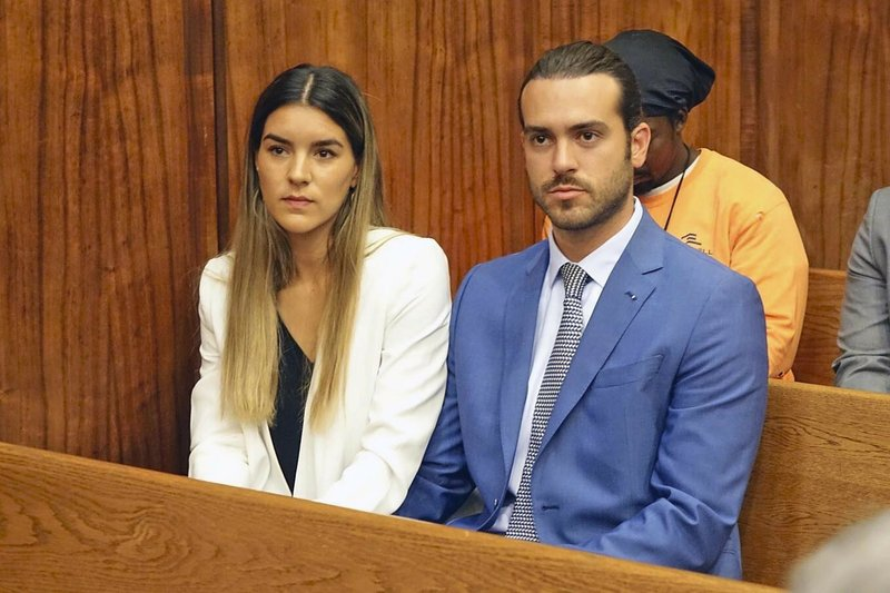 Mexican soap opera star Pablo Lyle, right, and his wife Ana Araujo wait before appearing in Miami-Dade, Fla. (David Ovalle/Miami Herald via AP)