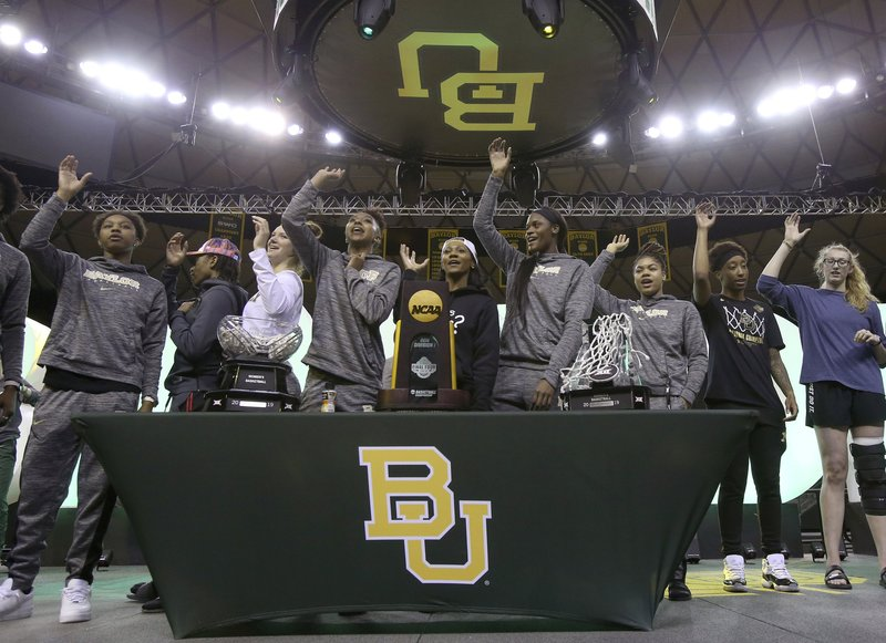 Baylor players give the sic 'em sign as they thank their fans who welcomed them home inside the Ferrell Center, Monday, April 8, 2019, in Waco, Texas, as NCAA Division I Women's basketball champions. (Jerry Larson/Waco Tribune Herald via AP)