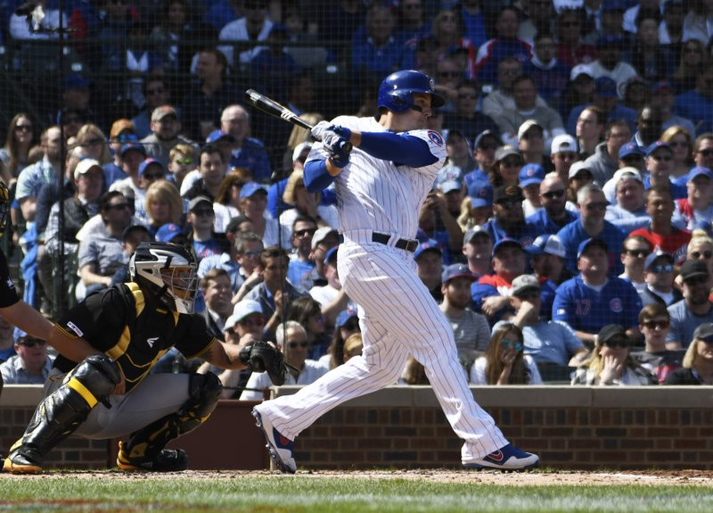 Chicago Cubs' Anthony Rizzo watches his RBI-single against the Pittsburgh Pirates during the second inning of a baseball game, Monday, April 8, 2019, in Chicago. (AP Photo/David Banks)