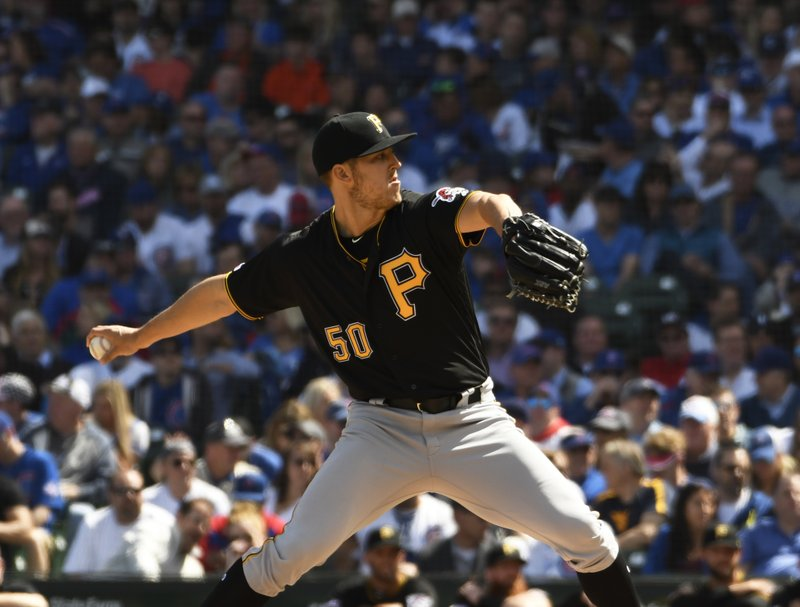 Pittsburgh Pirates starting pitcher Jameson Taillon (50) throws the ball against the Chicago Cubs during the first inning of a baseball game, Monday, April 8, 2019, in Chicago. (AP Photo/David Banks)