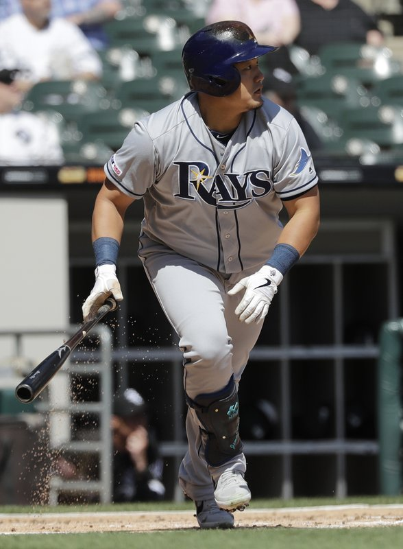 Tampa Bay Rays' Ji-Man Choi, of South Korea, watches after hitting a sacrifice fly to Chicago White Sox center fielder Adam Engel during the first inning of a baseball game in Chicago, Monday, April 8, 2019. (AP Photo/Nam Y. Huh)