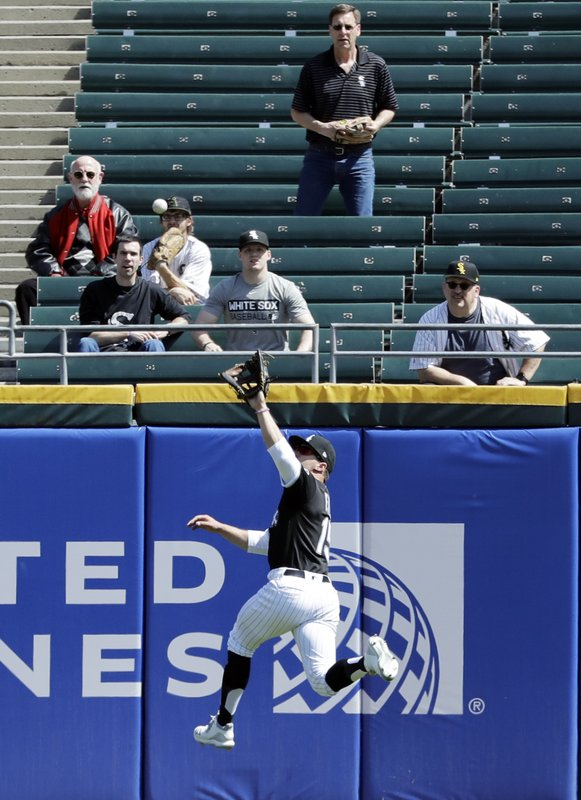 Chicago White Sox center fielder Adam Engel leaps to catch a sacrifice fly by Tampa Bay Rays' Ji-Man Choi, of South Korea, during the first inning of a baseball game in Chicago, Monday, April 8, 2019. (AP Photo/Nam Y. Huh)