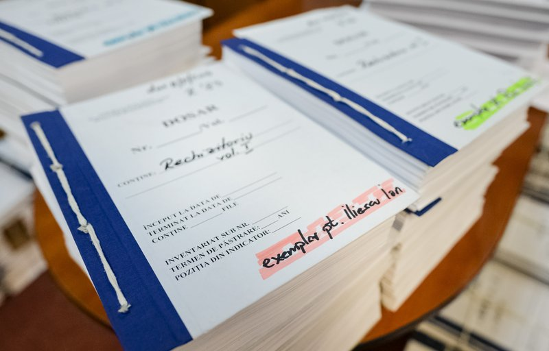 The copy for former Romanian President Ion Iliescu of the indictment papers for the 1989 anti-communist uprising is stacked for the media at the Public Ministry in Bucharest, Romania, Monday, April 8, 2019. (AP Photo/Andreea Alexandru)