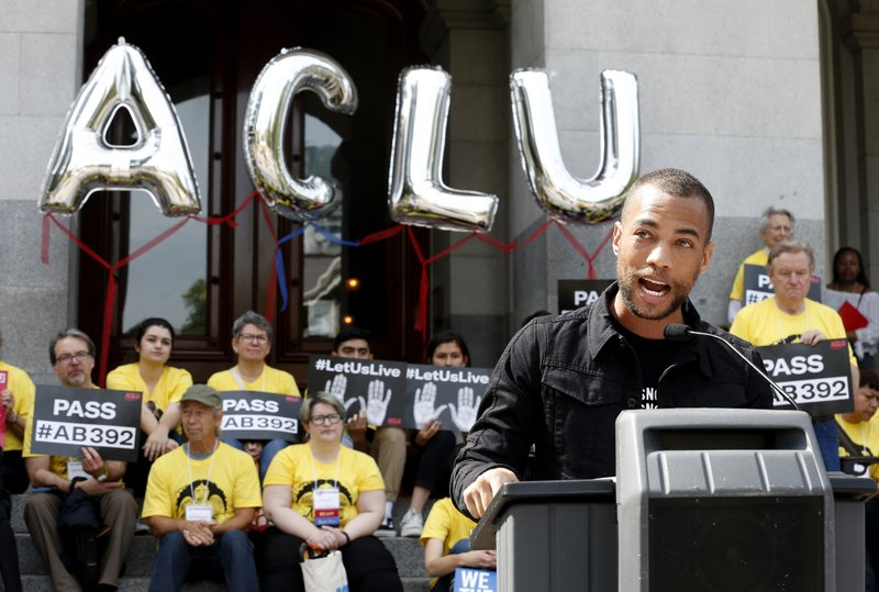 Actor Kendrick Sampson speaks in support of proposed measure to limit the use of deadly force by police during a rally at the Capitol, Monday, April 8, 2019, in Sacramento, Calif. (AP Photo/Rich Pedroncelli)