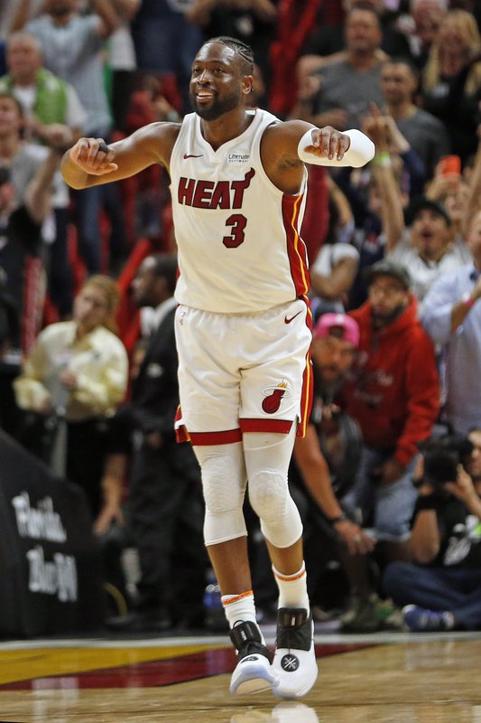 Miami Heat guard Dwyane Wade (3) runs up the court to celebrate the win against the Dallas Mavericks at an NBA basketball game, Thursday, March 28, 2019, in Miami. (AP Photo/Joel Auerbach)