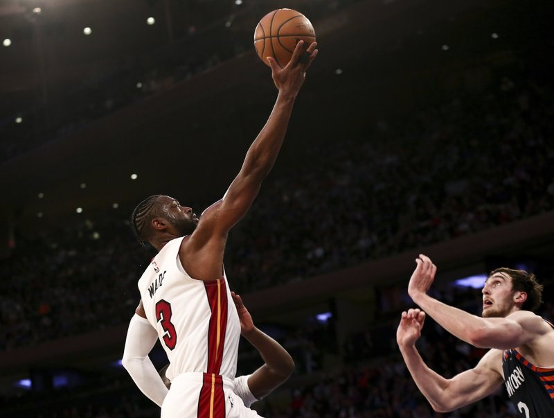 Miami Heat guard Dwyane Wade (3) shoots against New York Knicks forward Luke Kornet (2) during the first half of an NBA basketball game Saturday March 30, 2019, in New York. (AP Photo/Nicole Sweet)