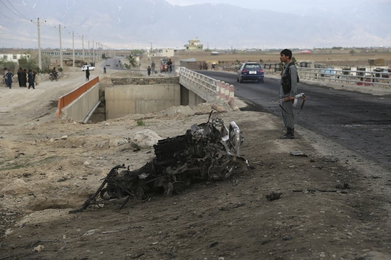 An Afghan security force stand guard at the site a day after an a suicide attack near the Bagram Air Base, north of Kabul, Afghanistan, Tuesday, April 9, 2019. (AP Photo/Rahmat Gul)