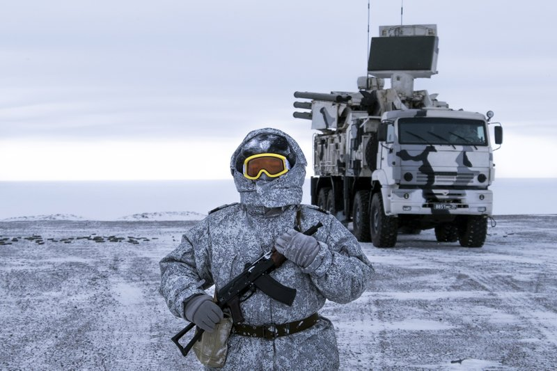 In this photo taken on Wednesday, April 3, 2019, a Russian solder stands guard as Pansyr-S1 air defense system on the Kotelny Island, part of the New Siberian Islands archipelago located between the Laptev Sea and the East Siberian Sea, Russia. (AP Photo/Vladimir Isachenkov)