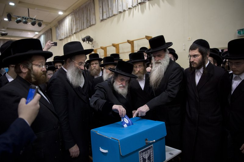 Rabbi Israel Hager votes for Israel's parliamentary election at a polling station in Bnei Brak, Israel, Tuesday, April 9, 2019. (AP Photo/Oded Balilty)