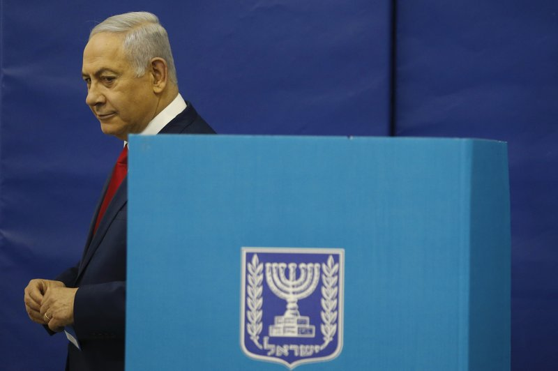 Israel's Prime Minister Benjamin Netanyahu votes during Israel's parliamentary elections in Jerusalem, Tuesday, April 9, 2019 (AP Photo/Ariel Schalit, Pool)