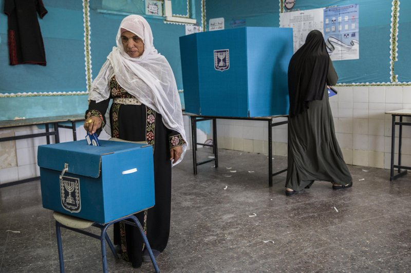 Israeli Bedouin woman votes during general elections in the city of Rahat, Tuesday, April 9, 2019. (AP Photo/Tsafrir Abayov)
