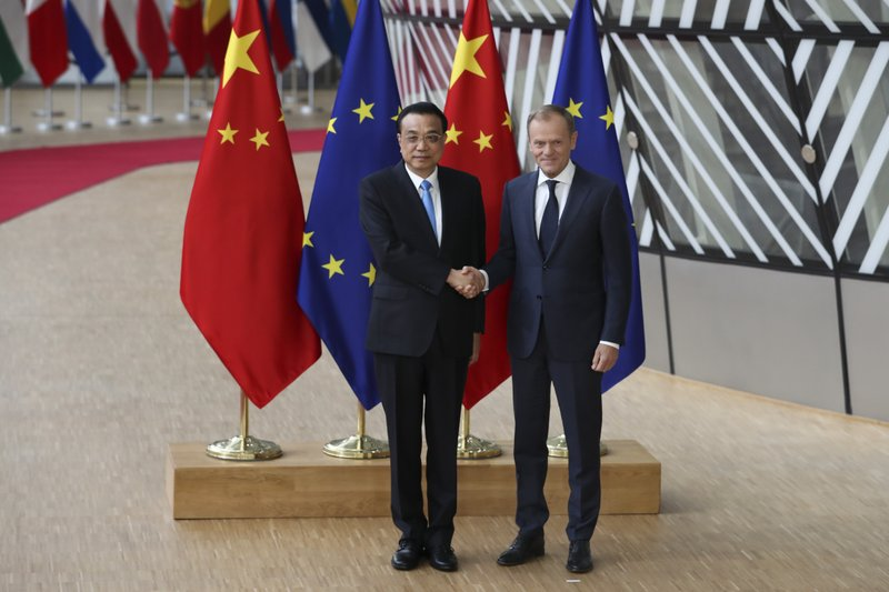 China's Premier Li Keqiang, left, shakes hands with European Council President Donald Tusk during an EU-China summit at the European Council headquarters in Brussels, Tuesday, April 9, 2019. (AP Photo/Francisco Seco)