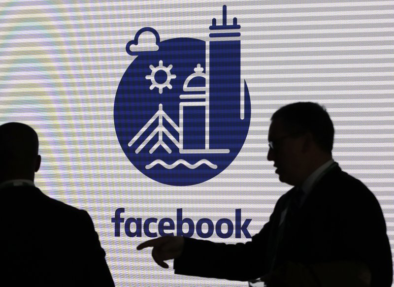 FILE - In this Jan. 9, 2019, file photo, media and guests mingle before a tour of Facebook's new 130,000-square-foot offices, which occupy the top three floors of a 10-story Cambridge, Mass. (AP Photo/Elise Amendola, File)