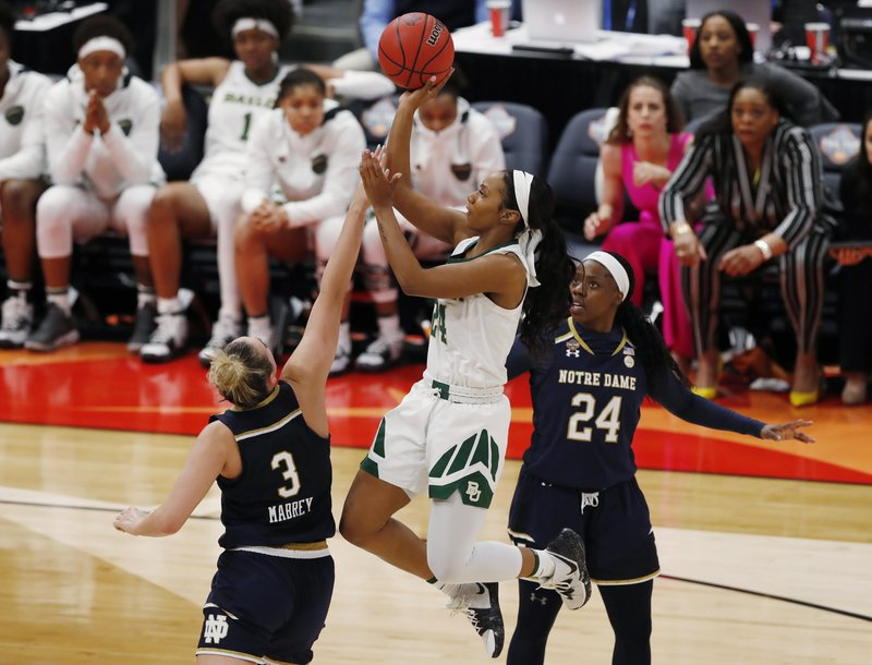Baylor guard Chloe Jackson (24) shoots between Notre Dame guards Marina Mabrey (3) and Arike Ogunbowale (24), during the second half of the Final Four championship game of the NCAA women's college basketball tournament Sunday, April 7, 2019, in Tampa, Fla. (AP Photo/Mark LoMoglio)