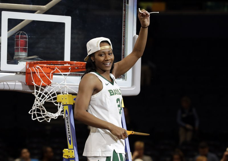 Baylor guard Chloe Jackson lifts a piece of the net during the post-game ceremony at the Final Four championship game of the NCAA women's college basketball tournament, Sunday, April 7, 2019, in Tampa, Fla. (AP Photo/Chris O'Meara)