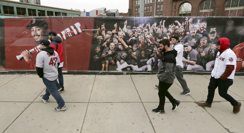 Fans arrive at Fenway Park for the home opener baseball game between the Boston Red Sox and the Toronto Blue Jays, Tuesday, April 9, 2019, in Boston. (AP Photo/Charles Krupa)