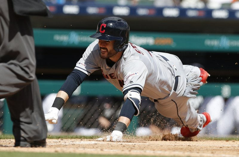 Cleveland Indians' Eric Stamets beats the throw to safely slide at home during the seventh inning of a baseball game against the Detroit Tigers, Tuesday, April 9, 2019, in Detroit. (AP Photo/Carlos Osorio)