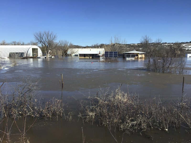 In this undated March 2019 photo provided by Henry Red Cloud, shows flooding on Cloud's Lakota Solar Enterprises property on the Pine Ridge Reservation in southern South Dakota. (Henry Red Cloud via AP)