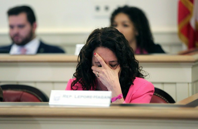 Ohio Representative Michele Lepore-Hagan wipes tears from her face during a hearing to propose amendments to the