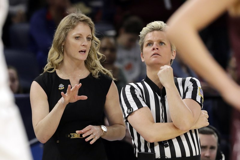 Missouri State head coach Kellie Harper, left, argues a call during the first half of a regional semifinal game against Stanford in the NCAA women's college basketball tournament, Saturday, March 30, 2019, in Chicago. (AP Photo/Nam Y. Huh)