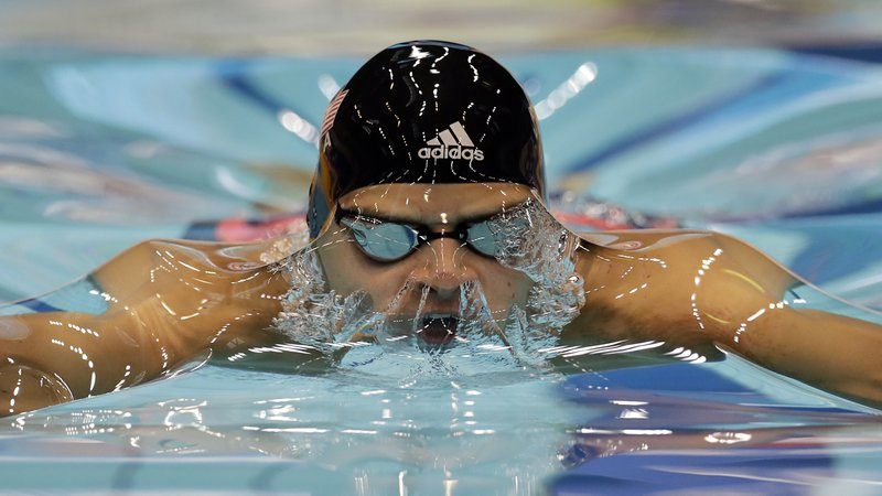FILE - In this Tuesday, Aug. 30, 2016 file photo, United States's Michael Andrew swims the men's 50-meter breaststroke final at the Fina short course swimming World Cup in Berlin, Germany. (AP Photo/Michael Sohn, File)