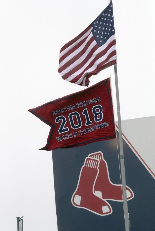 The Boston Red Sox 2018 World Series Champions pennant flies over center field during the fourth inning of the home opener baseball game between the Red Sox and Toronto Blue Jays, Tuesday, April 9, 2019, in Boston. (AP Photo/Charles Krupa)