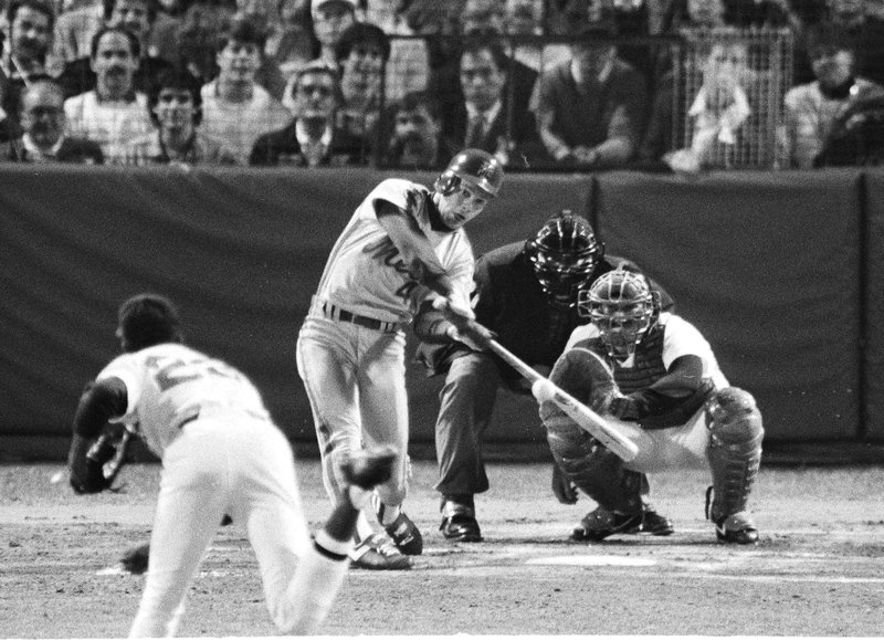 FILE - In this Oct. 21, 1986, file photo, New York Mets' Lenny Dykstra hits a first-inning home run off Boston Red Sox pitcher Dennis