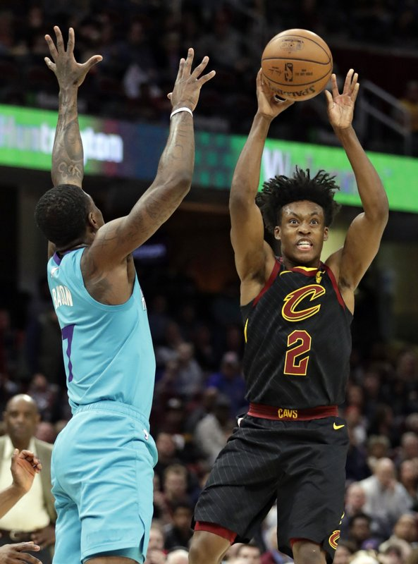 Cleveland Cavaliers' Collin Sexton (2) passes against Charlotte Hornets' Dwayne Bacon (7) in the first half of an NBA basketball game, Tuesday, April 9, 2019, in Cleveland. (AP Photo/Tony Dejak)