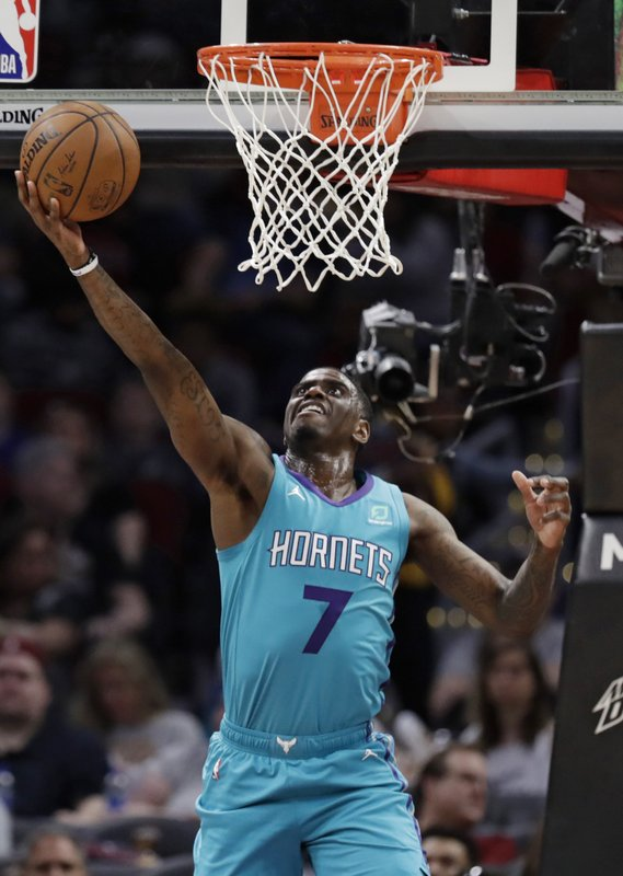 Charlotte Hornets' Dwayne Bacon drives to the basket against the Cleveland Cavaliers in the first half of an NBA basketball game, Tuesday, April 9, 2019, in Cleveland. (AP Photo/Tony Dejak)