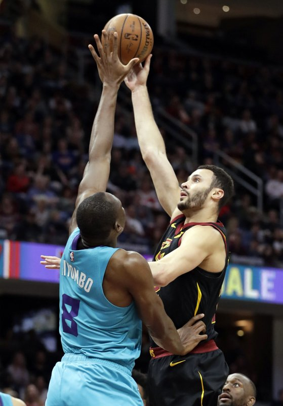 Cleveland Cavaliers' Larry Nance Jr., right, shoots over Charlotte Hornets' Bismack Biyombo in the first half of an NBA basketball game, Tuesday, April 9, 2019, in Cleveland. (AP Photo/Tony Dejak)