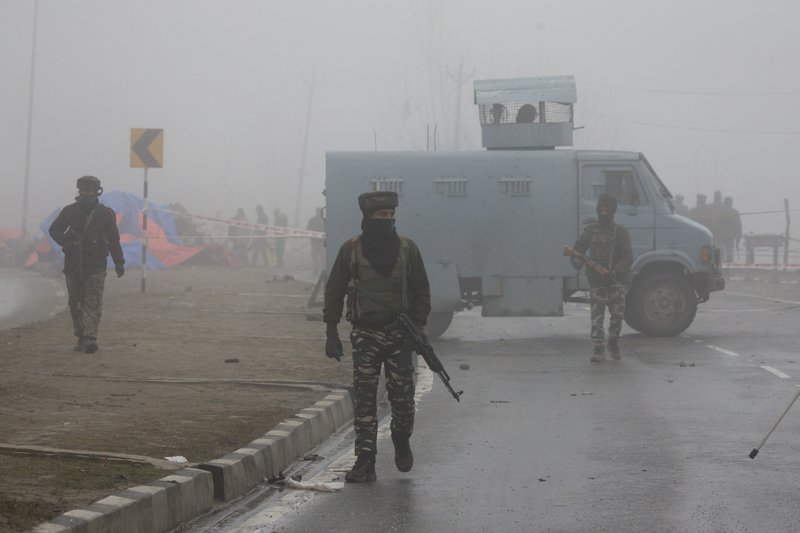 FILE-In this Feb. 15, 2019, file photo, Indian paramilitary soldiers patrol near the site of Thursday's explosion in Pampore, Indian-controlled Kashmir. (AP Photo/Dar Yasin, File)