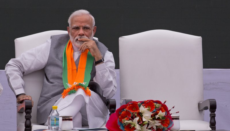 In this Monday, April 8, 2019, photo, India's Prime Minister Narendra Modi releases Bharatiya Janata Party or BJP's manifesto for the upcoming general elections in New Delhi, India. (AP Photo/Manish Swarup)