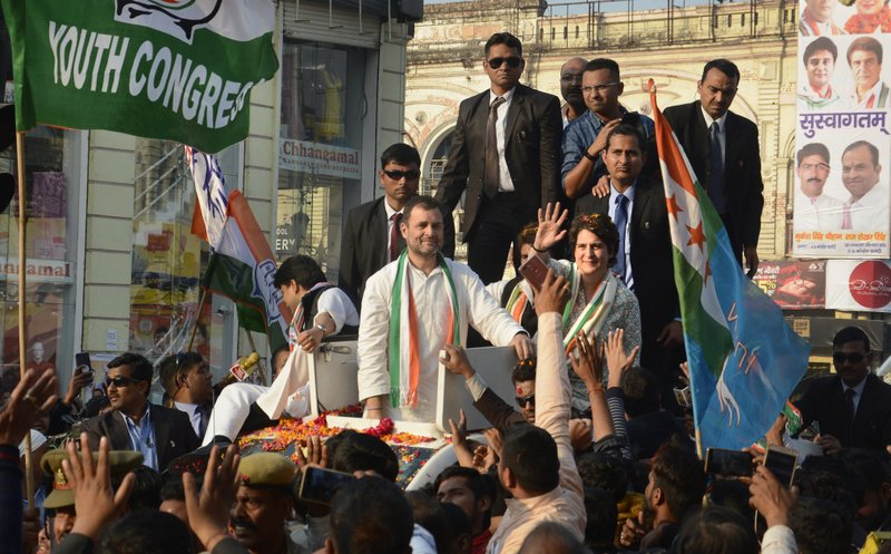 FILE- In this Feb. 11, 2019, file photo, Congress party president Rahul Gandhi, center, looks on as his sister Priyanka Gandhi Vadra, right, waves at supporters during a rally in Lucknow, India. (AP Photo/Nirala Tripathi, file)