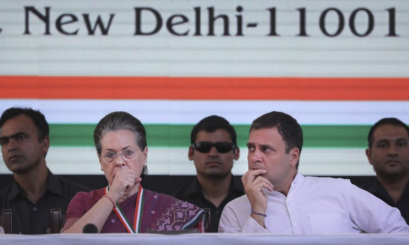 In this in April 2, 2019, photo, United Progressive Alliance Chairperson Sonia Gandhi, second left, sits with her son and Congress Party President Rahul Gandhi, second right, at the India National Congress party headquarters to release its manifesto for the upcoming general election, in New Delhi, India. (AP Photo/Manish Swarup)